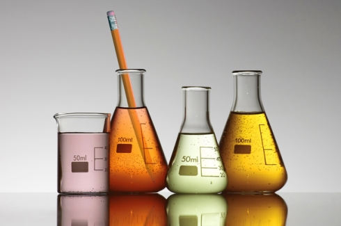 Beakers with a pencil