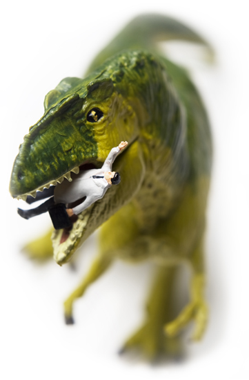 Dinosaur toy eating a business man toy figure